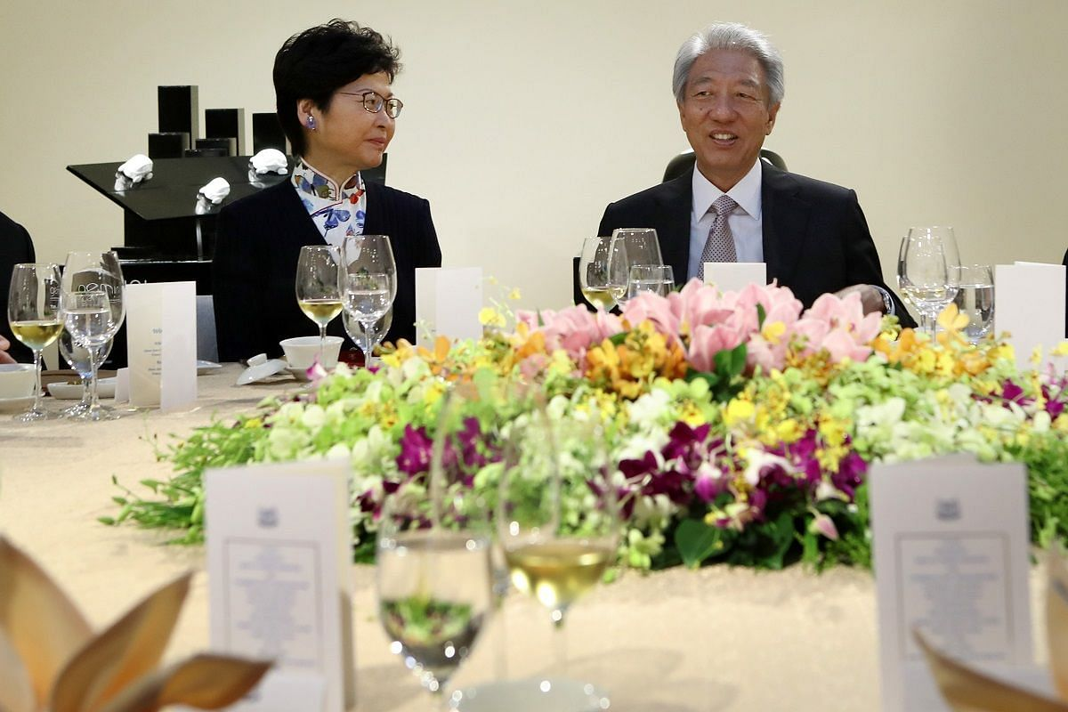 Deputy Prime Minister Teo Chee Hean plays host to Mrs Carrie Lam at lunch on Aug 3 at Create Gallery, National University of Singapore.