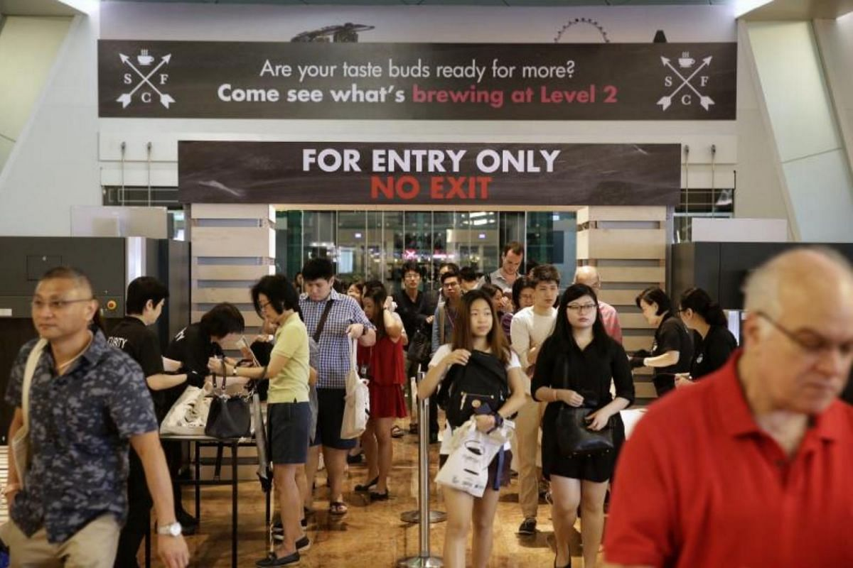 Visitors streaming in during the second day of the Singapore Coffee Festival on Aug 5, 2017.