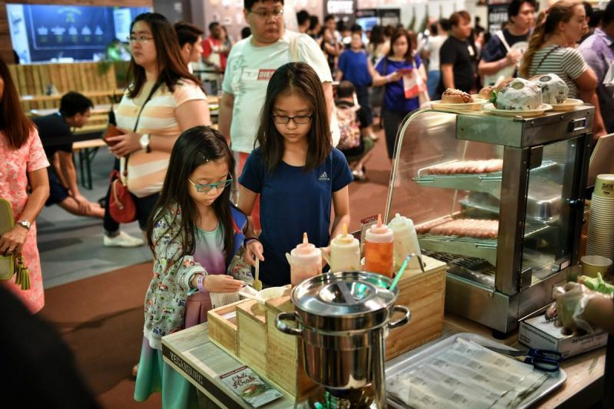 The second day of the Singapore Coffee Festival drew crowds of visitors, including children.