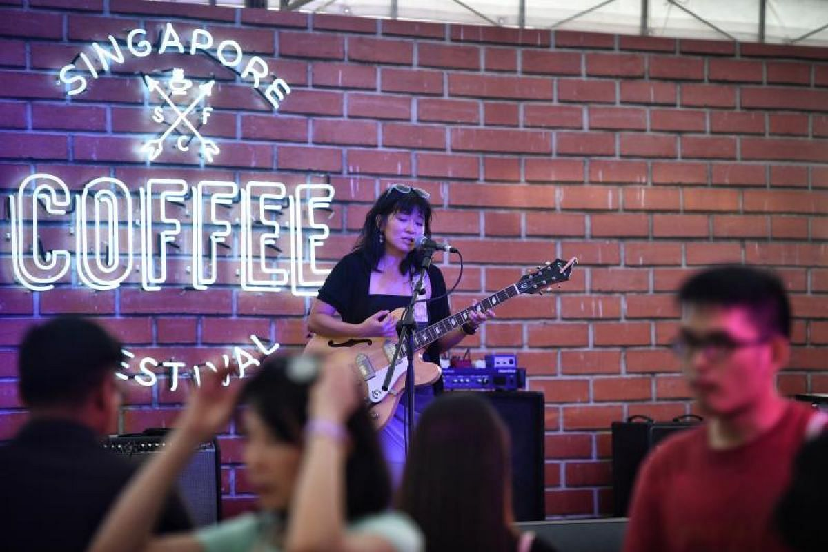 Inch Chua performs at Sunset Wharf on the second day of the Singapore Coffee Festival.