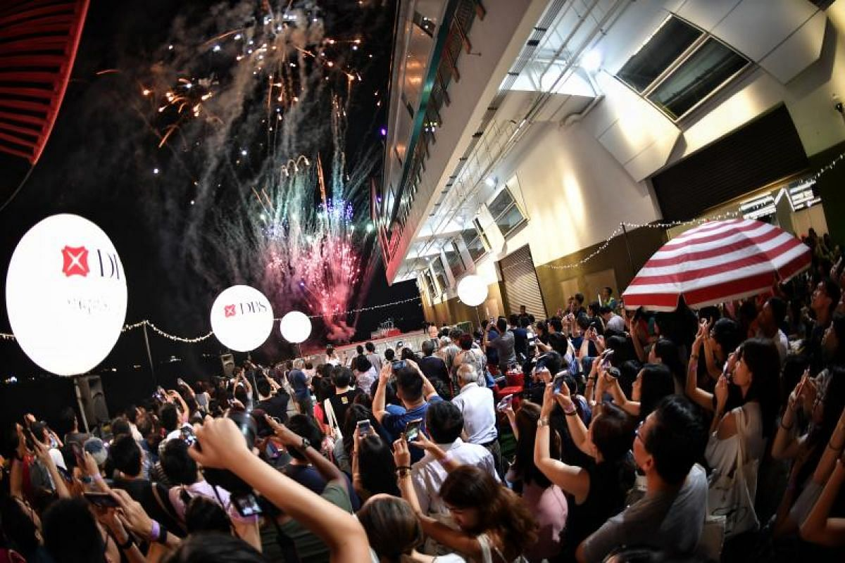 Visitors to the Singapore Coffee Festival watch the evening fireworks display on Aug 5, 2017.