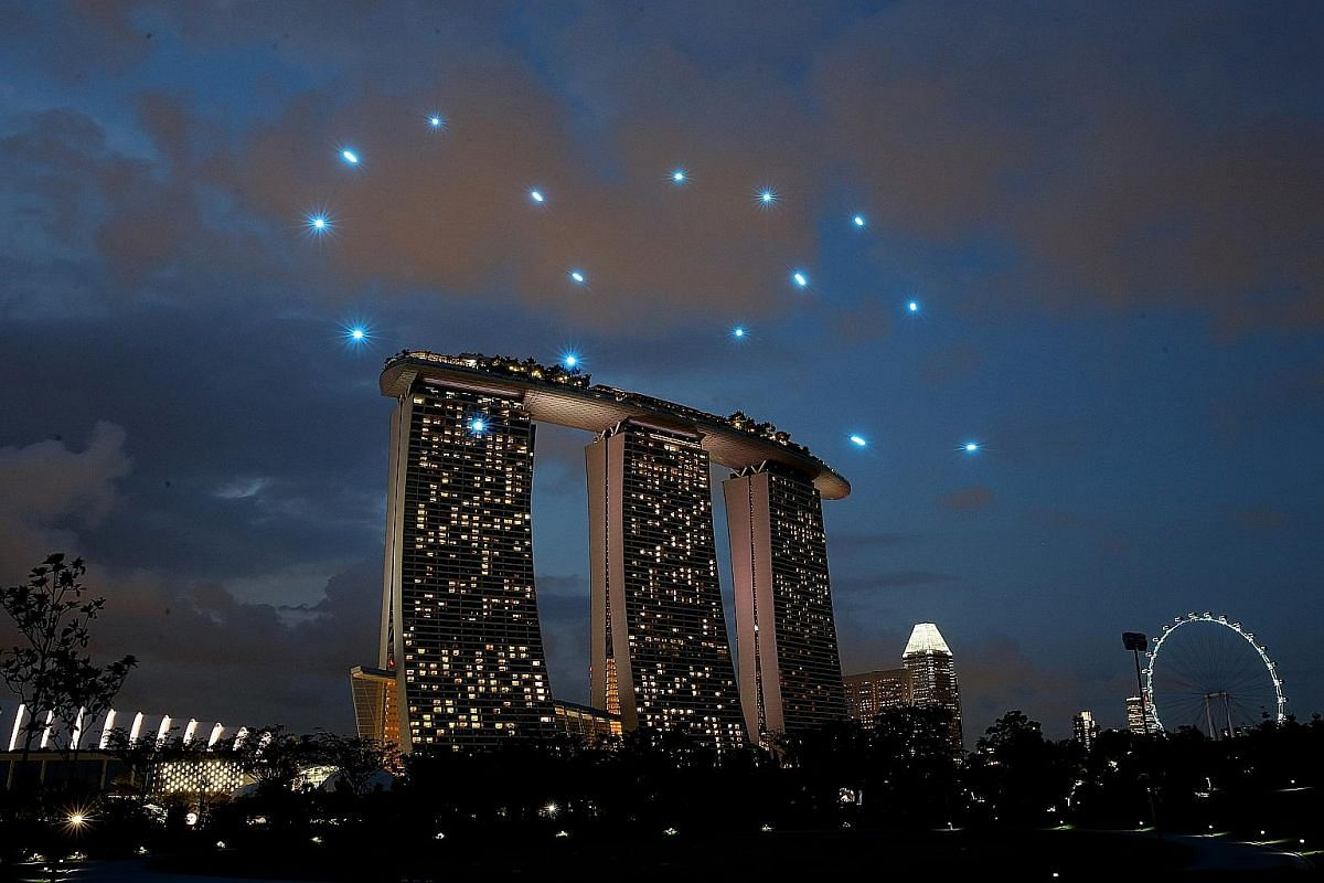 An illustration of the seven drone formations (left) at this year's National Day Parade. Images are for illustration only and may differ during actual performance. A multi-drone display as part of the exhibition titled The Future Of Us at Gardens by