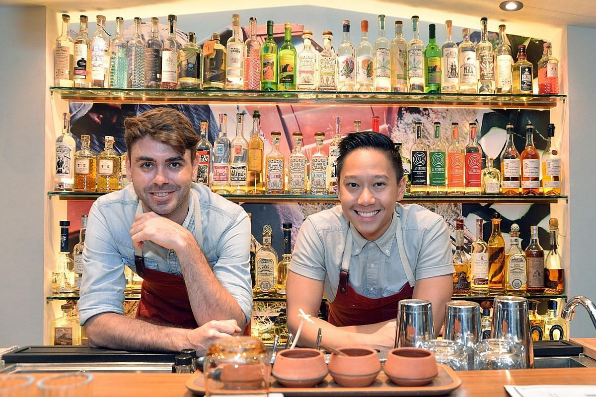 Junior's head bartenders Zachary De Git (left) and Peter Chua have more than 100 bottles of tequila, mezcal and other Mexican spirits by independent and craft producers on offer.