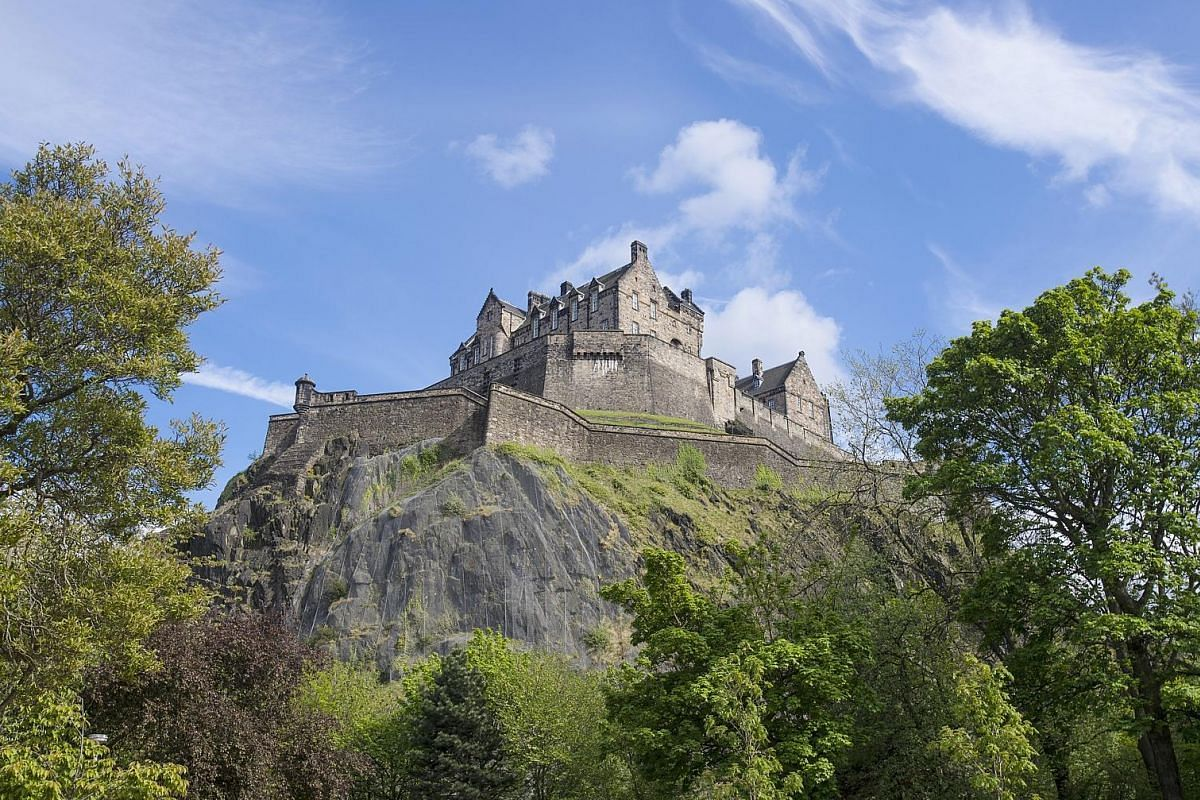 Edinburgh Castle sits dramatically atop a rock overlooking the city and the surrounding landscape.