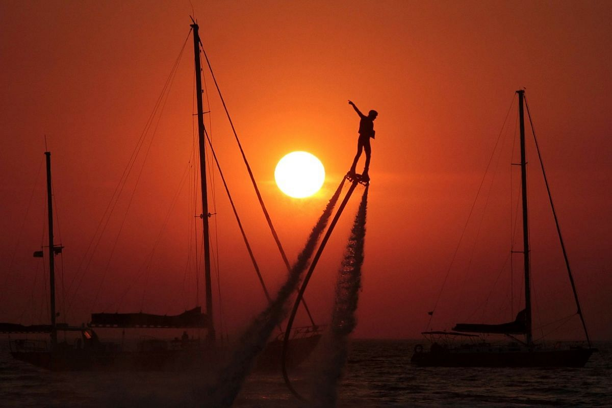 A man practices flyboarding near the village of Olenevka, Crimea, on Aug 5.