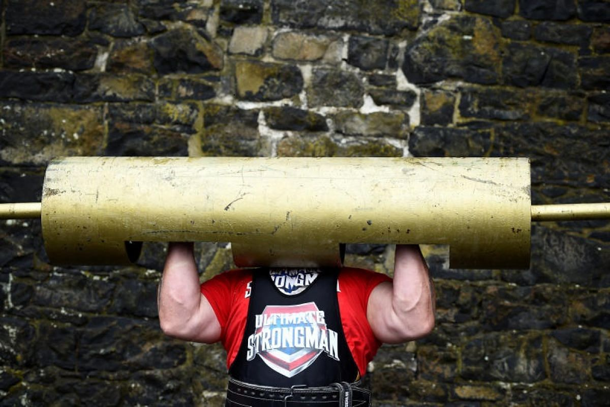 A competitor warms up before the Ultimate Strongman Masters World Championship in Belfast on Aug 6.