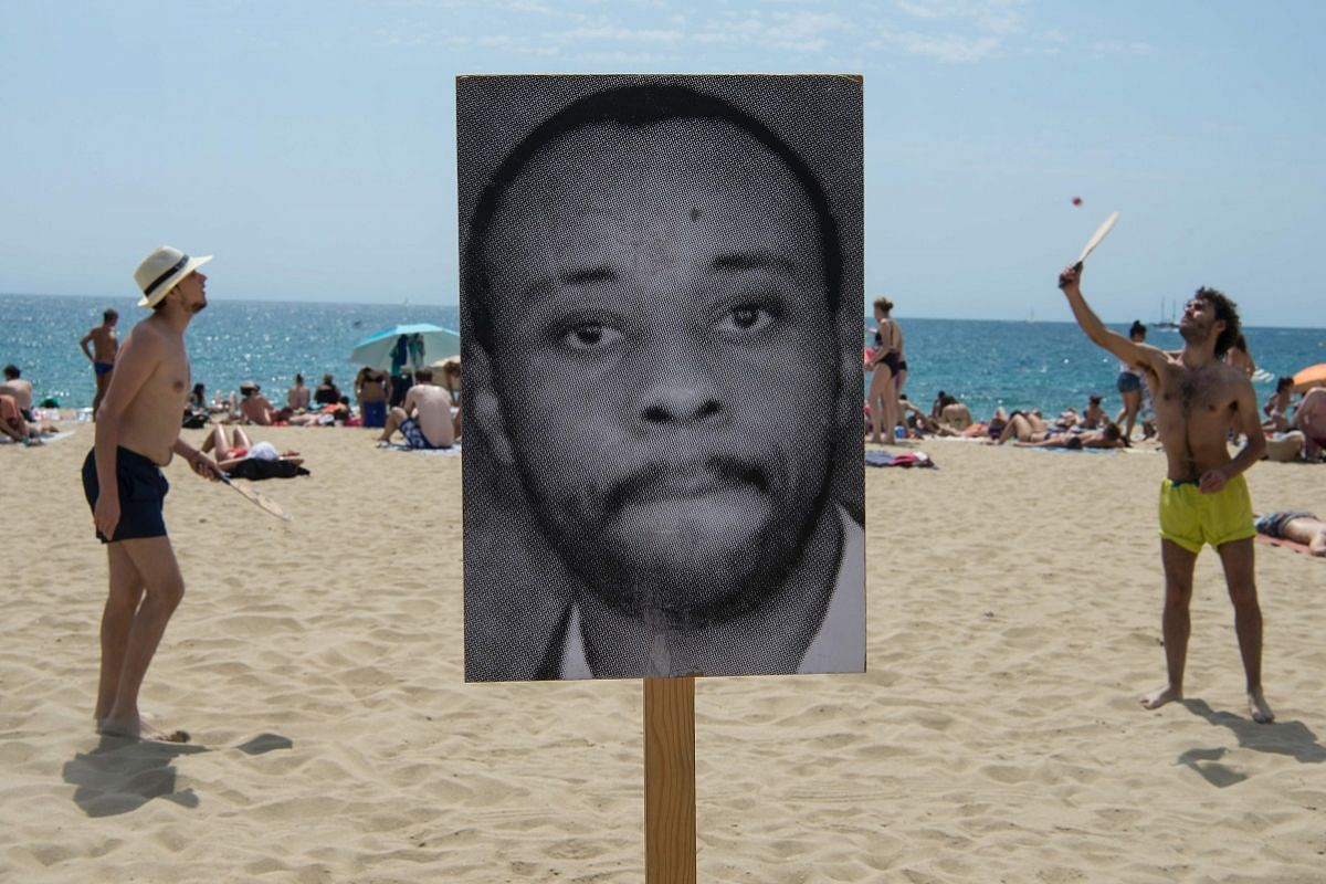 A photograph of a dead migrant, put up on Barcelona's Bogatell beach by pro-human rights organisations Tanquem Els CIE (Let's Close The Foreigners Detention Centres), Immigrant Space, Watch The Med and Stop Mare Mortum to pay tribute to the thousands