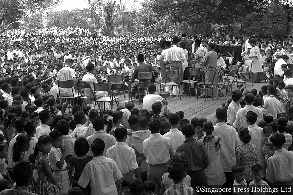 "1959: A large crowd gathers at Botanic Gardens for the inaugural Aneka Ragam Ra'ayat (""people's variety show"") concert. The show was part of a series of open-air concerts sponsored by the Ministry of Culture to promote a Malayan outlook, with per"