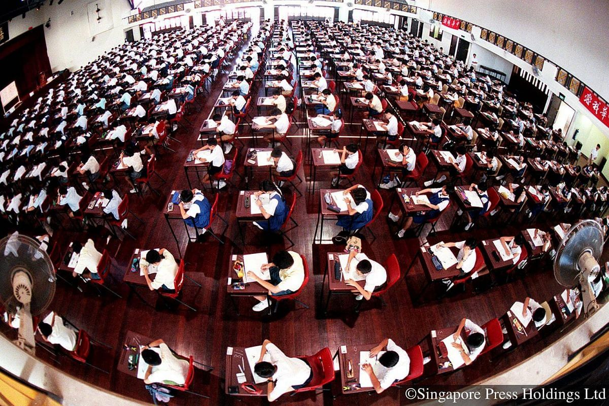 1997: Students in full concentration pit their problem-solving skills against each other at the annual Singapore Mathematical Olympiad.