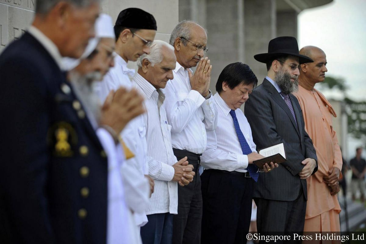 2011: Leaders from various religious groups offer prayers during the Remembrance Day service at Kranji War Cemetery. The annual service is a reminder for Singaporeans not to take peace and religious harmony for granted.