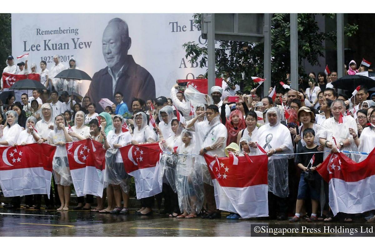2015: Singaporeans braved the pouring rain as they wait patiently for former prime minister Mr Lee Kuan Yew's cortege to pass on 29 March. Mr Lee passed away on 23 March, prompting a large outpouring of emotion and tributes from Singaporeans from a