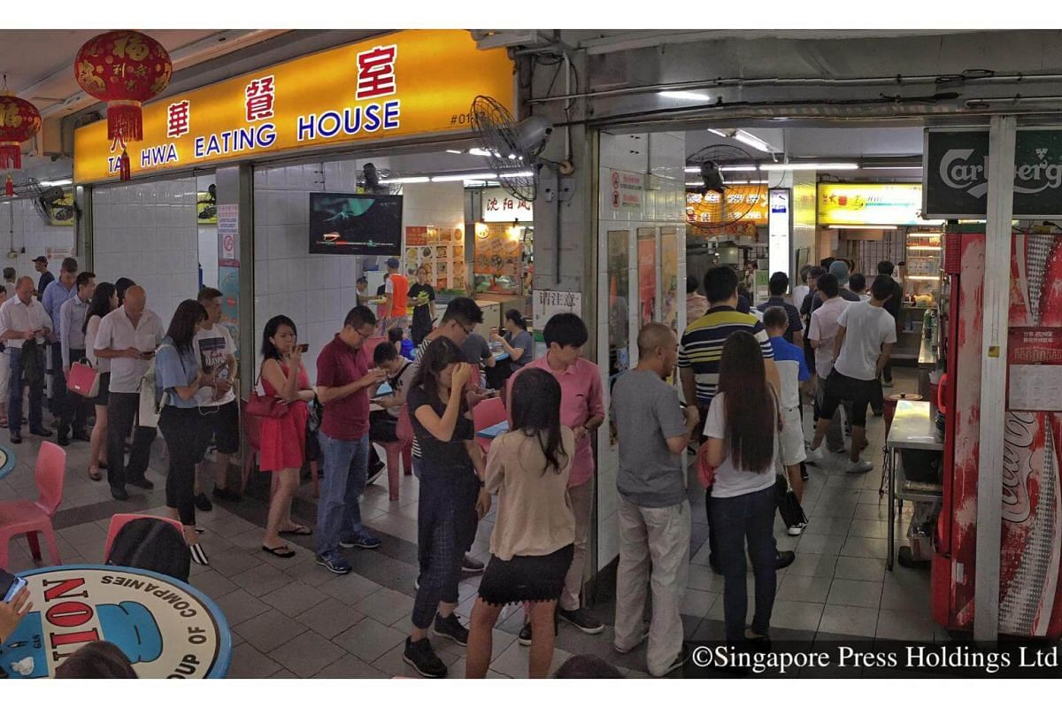 2016 :A long queue at Hill Street Tai Hwa Pork Noodle during lunchtime. The hawker stall in Crawford Lane was awarded a Michelin star in the inaugural Singapore Michelin food guide.