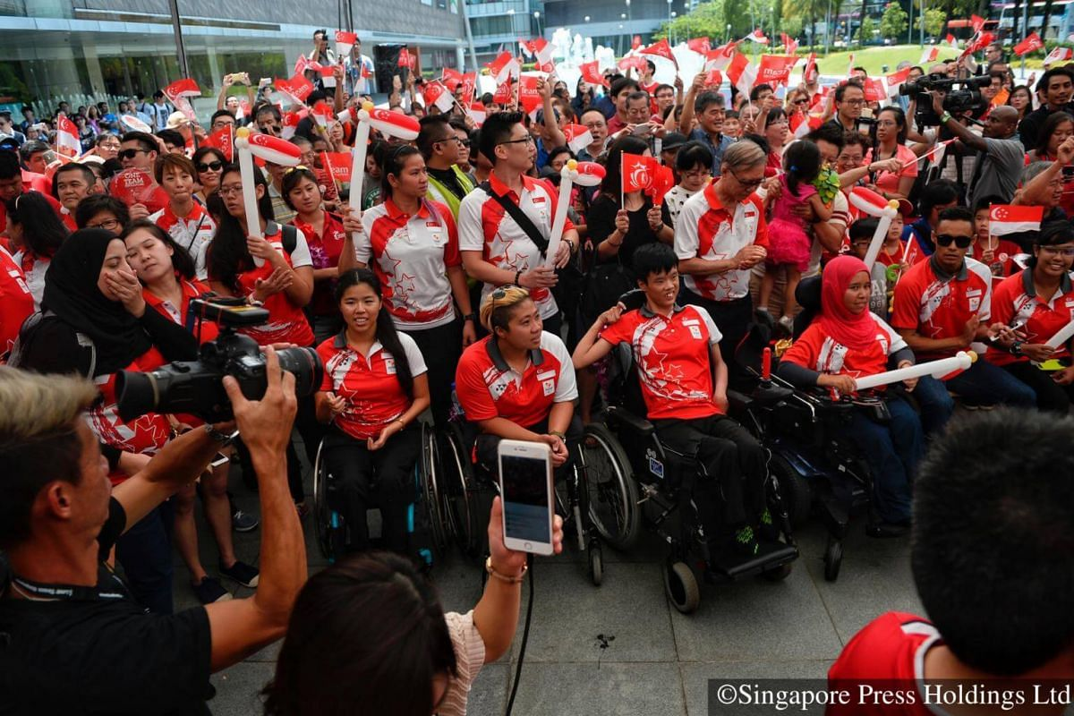 2016: Paralympic athletes and their supporters taking photographs during the One Team Singapore celebratory parade for the Rio 2016 Paralympians  The team gave their best performance at the Games, winning two golds and one bronze, all from swimming.
