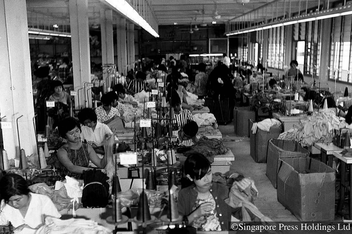 1967: Rapid industrialisation provided job opportunities for more people. Women factory workers in a garment factory in Commonwealth Drive.