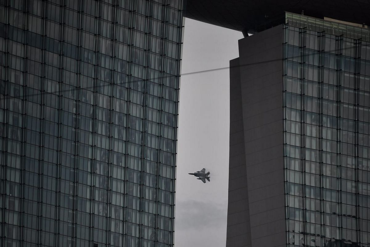 An RSAF F-15SG is seen flying behind Marina Bay Sands, during the National Day Parade on Aug 9, 2017.