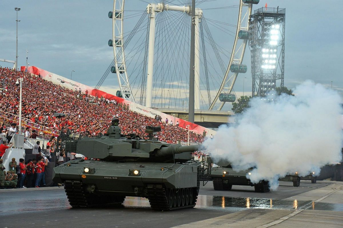A Leopard tank at the head of an armoured column firing its main gun, during the National Day Parade on Aug 9, 2017.