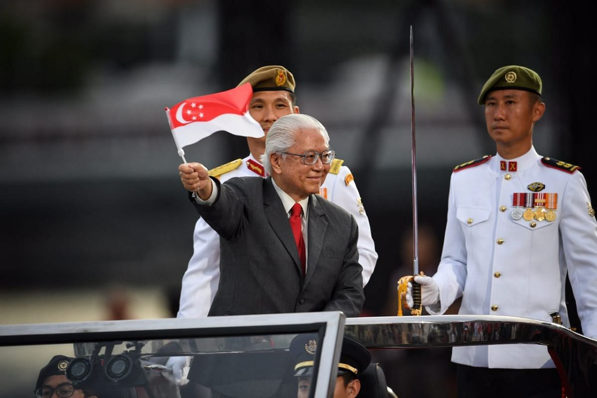 President Tony Tan Keng Yam waving a Singapore flag during the National Day Parade on Aug 9, 2017.