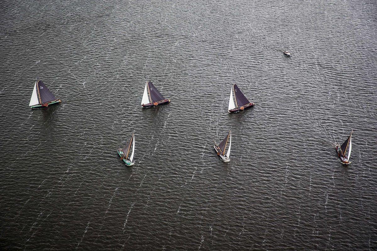 An aerial view of yachts in the Skutsjesilen competition, a traditional boat race, near Sneekermeer, The Netherlands, on Aug 9.