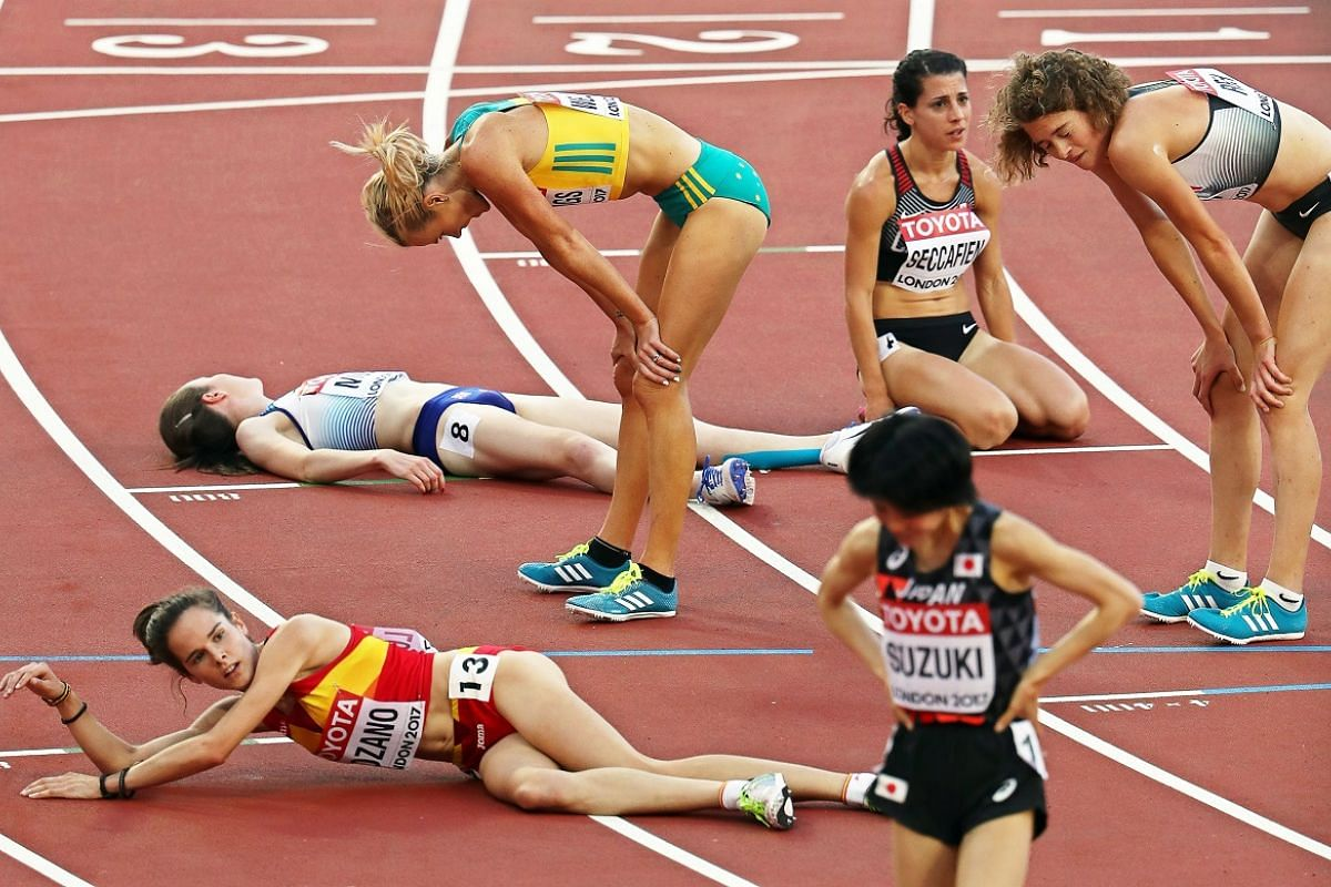 Going flat out: Athletes after the women's 5,000m heats on Aug 10.