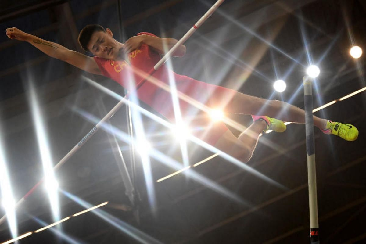 China's Xue Changrui in the men's pole vault final on Aug 8.
