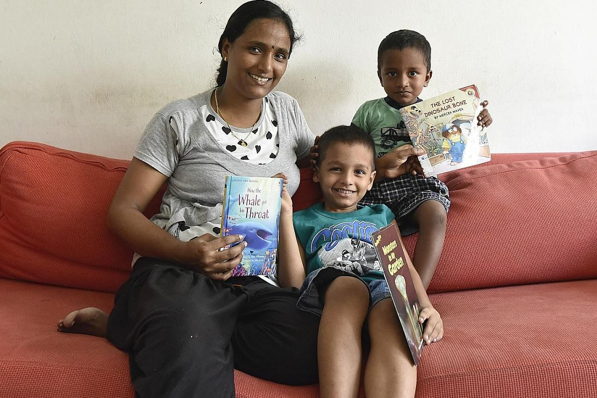 Housewife Shanmugam Rekha uses diverse ways, such as attending story-telling at libraries, to teach her sons Rakshith, six, and Jai Rakshan, two, to read.