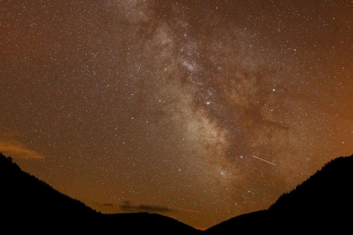 The Milky Way is seen during the annual Perseid meteor shower above Salime Reservoir, Spain.