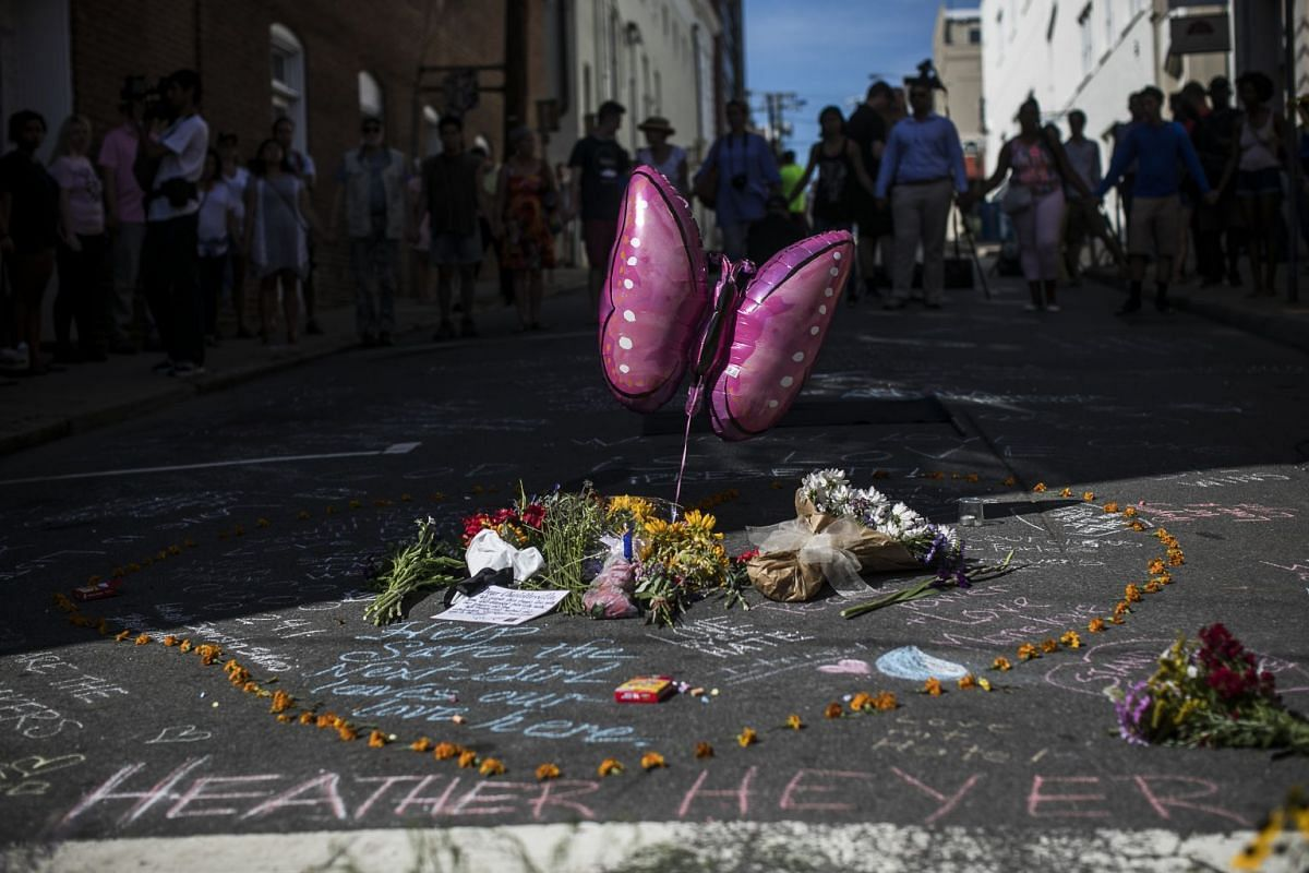 """A makeshift memorial, at the site where on Saturday a car plowed into a group of counter-protesters after a """"Unite the Right"""" rally by white nationalist groups, in Charlottesville, Va., Aug. 13, 2017. A woman was killed and at least 19 were injured,"""