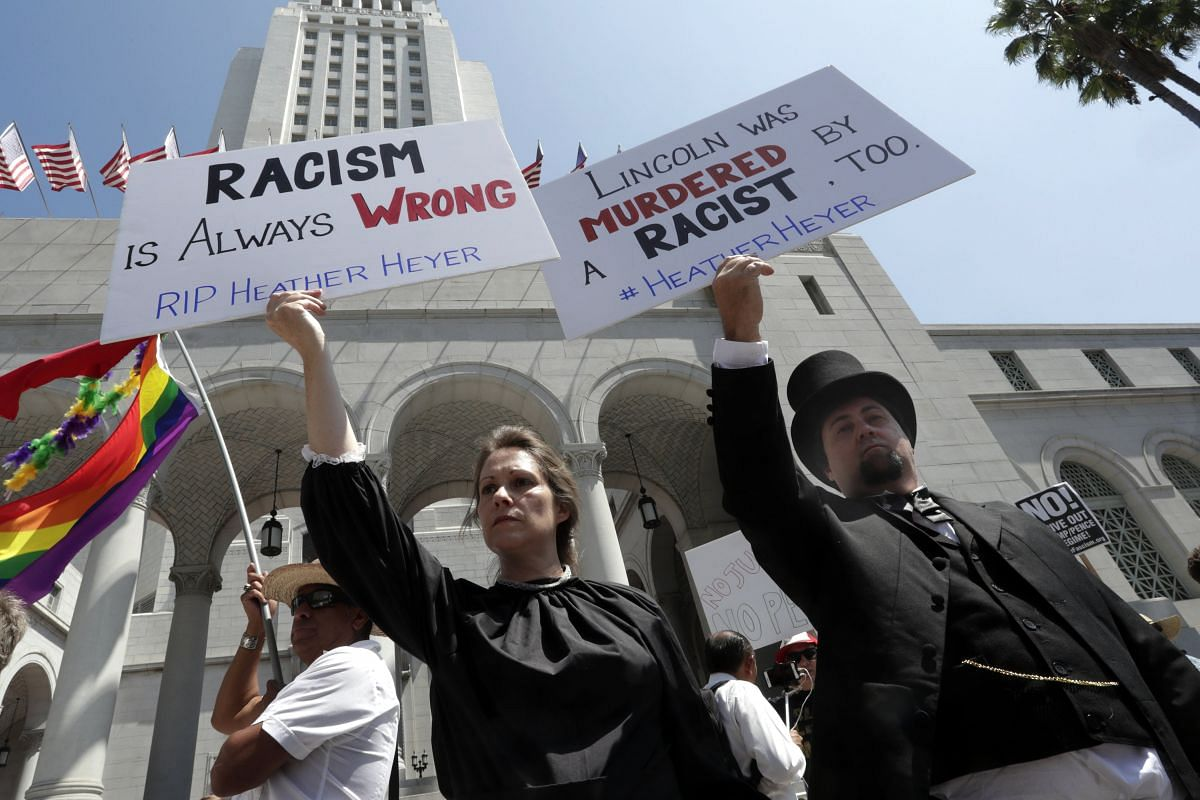 Mr Mike Stutz and Ms Laurel Trotter went dressed as former US president Abraham Lincoln and First Lady Mary Todd as they joined hundreds of demonstrators in front of the Los Angeles City Hall on Sunday.