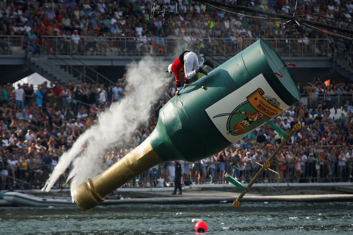 A participant from the Squadron of Flying Hussars operates a self-made flying machine during the Red Bull Flugtag Russia 2017 competition in Moscow, Russia, August 13, 2017. PHOTO: REUTERS