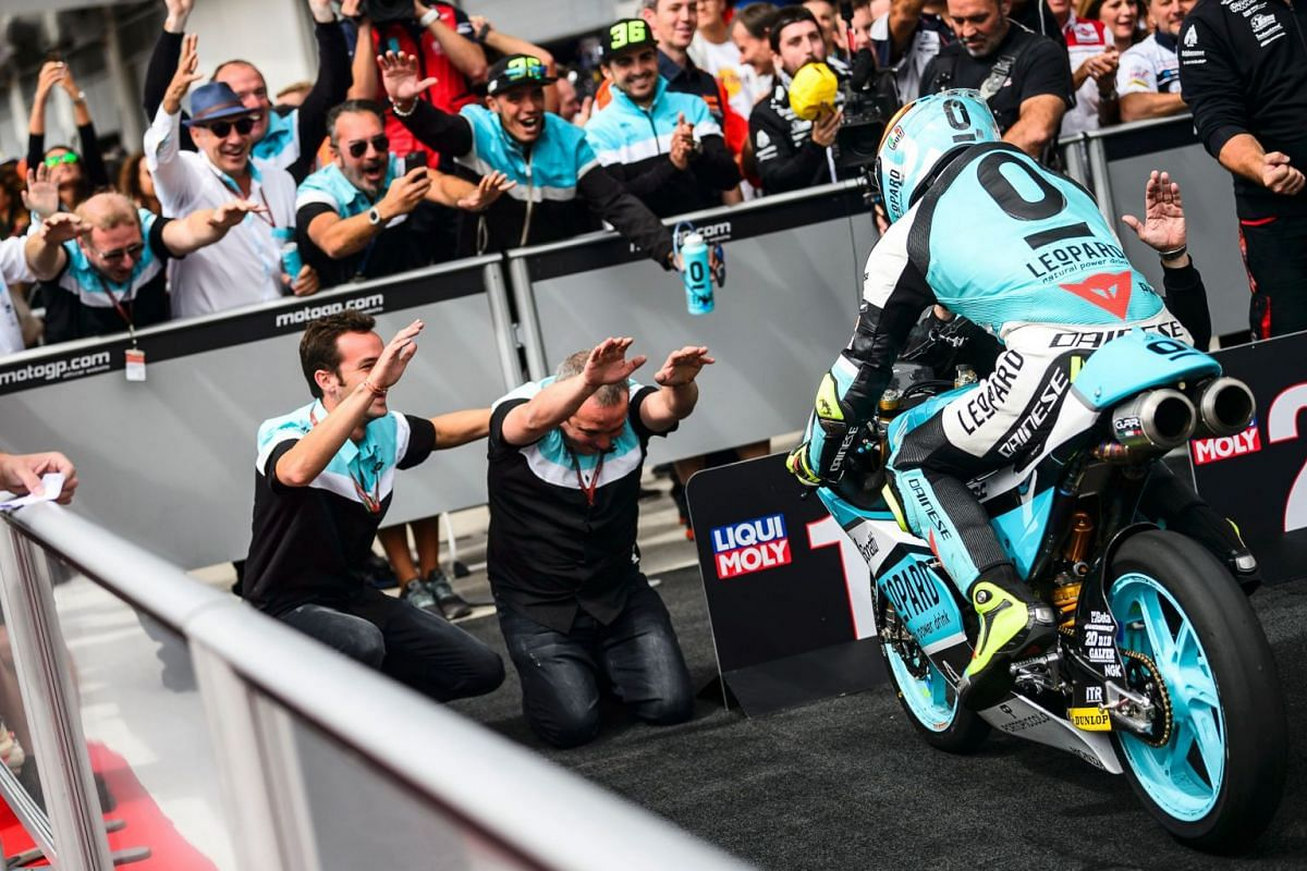 Leopard Racing's Spanish rider Joan Mir (R) celebrates after winning the Moto3 Austrian Grand Prix race at Red Bull Ring in Spielberg, Austria on August 13, 2017. PHOTO: AFP