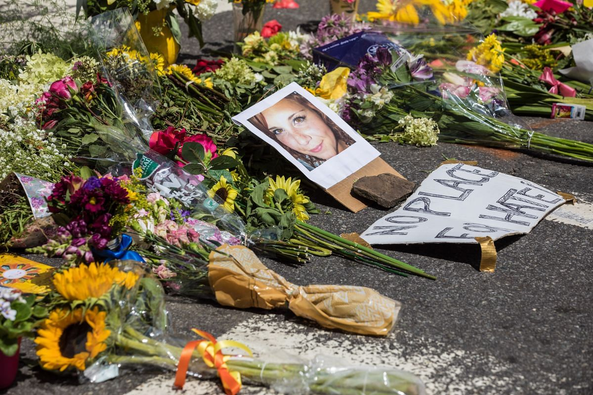 A  picture of Ms Heather Heyer, 32, at a memorial that grew at the site of the deadly car attack in Charlottesville, Virginia, on Saturday.