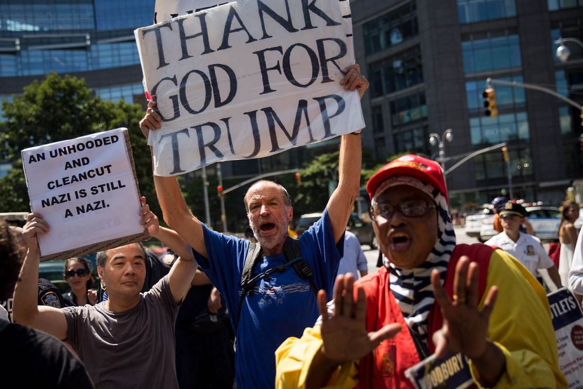 A supporter of President Donald Trump making his voice heard during a protest against white supremacy and racism organised by group called Refuse Fascism in New York City on Sunday.