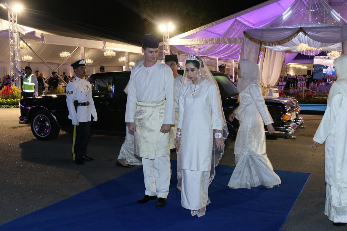 ": Dennis and his bride, Princess Tunku Aminah, arriving at the Grand Palace in Johor Bahru for the ""sitting-in-state"" ceremony on Aug 14, 2017."
