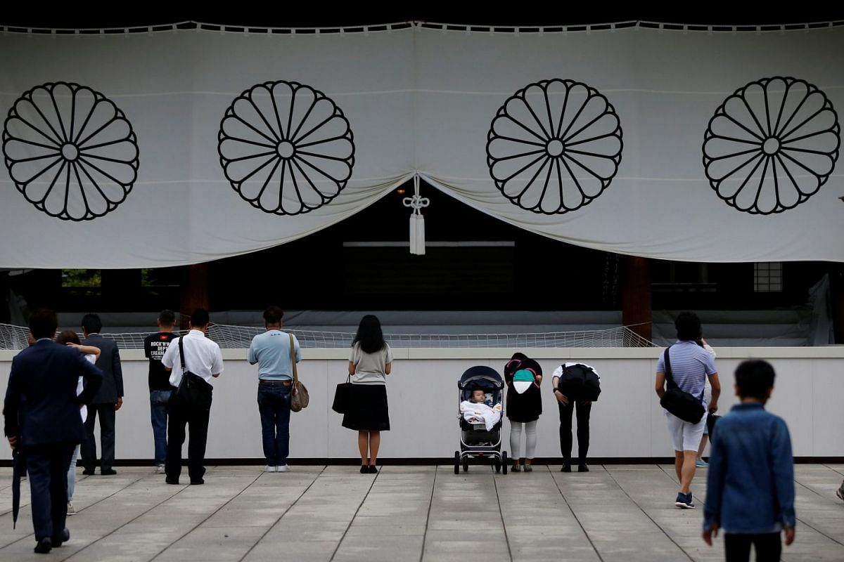 Visitors paying tribute to the war dead at Yasukuni Shrine in Tokyo, Japan, on Aug 15. This is the day that Japan surrendered in World War II, 72 years ago.