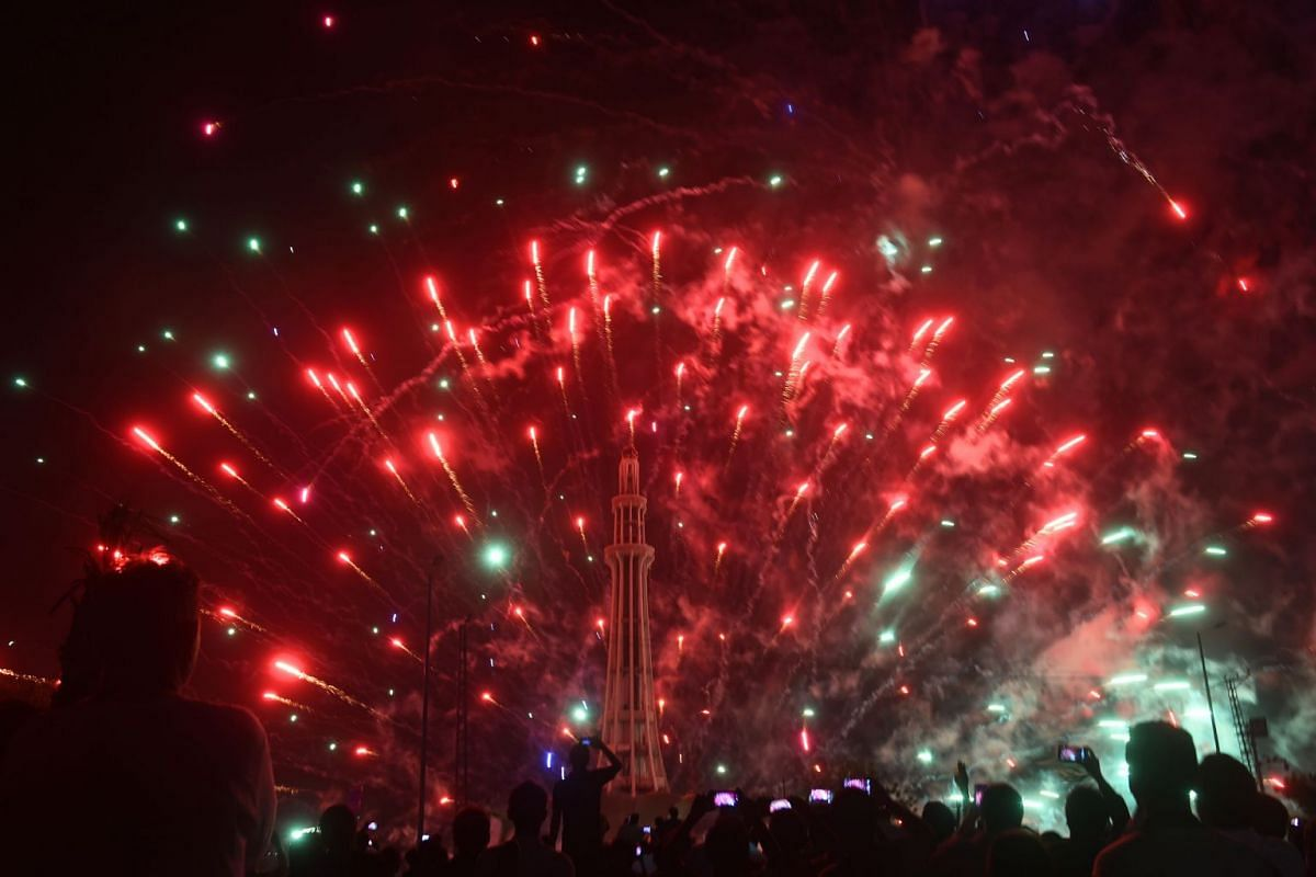 Fireworks light up the sky at midnight in Lahore. Similar pyrotechnic displays kicked off Independence Day celebrations in many cities around the country.