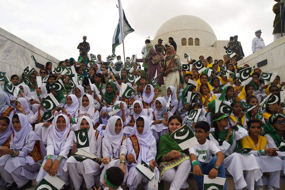 Students at a ceremony at the mausoleum of Pakistan's founder Mohammad Ali Jinnah in Karachi, where politicians and military officers laid wreaths.