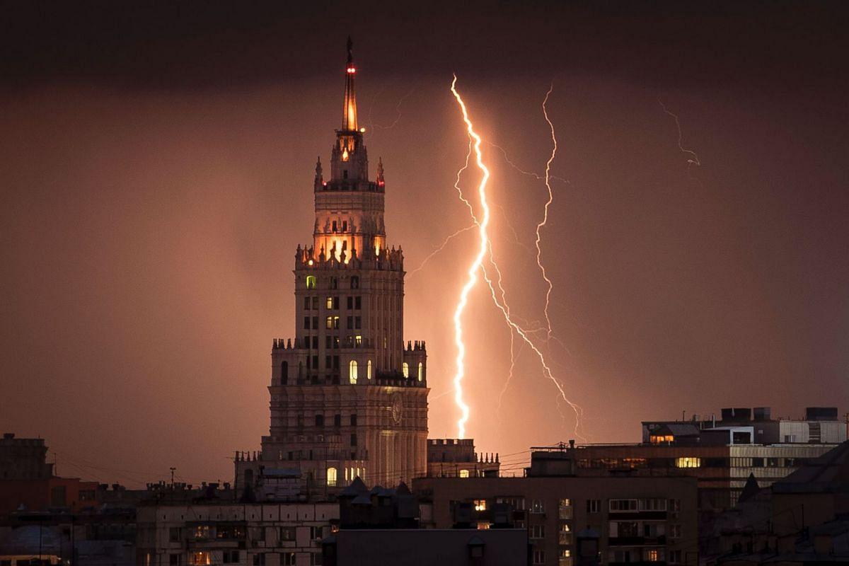 Lightning striking a Stalin-era skyscraper during a storm over Moscow on Aug 14.