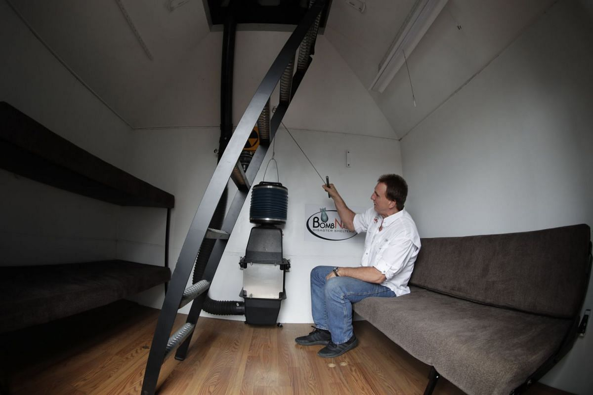 Mr Hubbard demonstrating the air-circulation system of the popular BombNado bomb shelter. According to the company website, the ventilation system protects against nuclear, biological and chemical contamination.