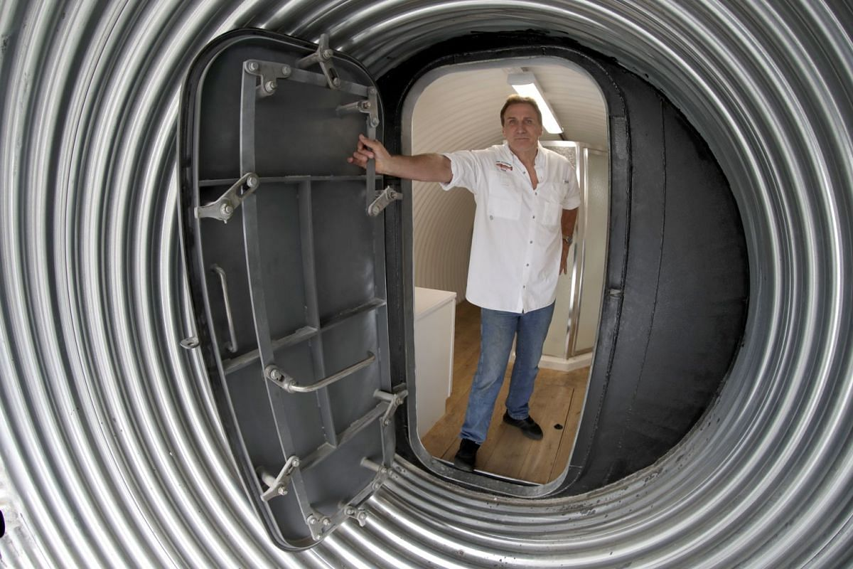 Mr Ron Hubbard at the entrance of a 25m-long bomb shelter that can hold six people. He owns Atlas Survival Shelters, a California-based company that builds underground shelters as protection against biological, nuclear and chemical attacks.