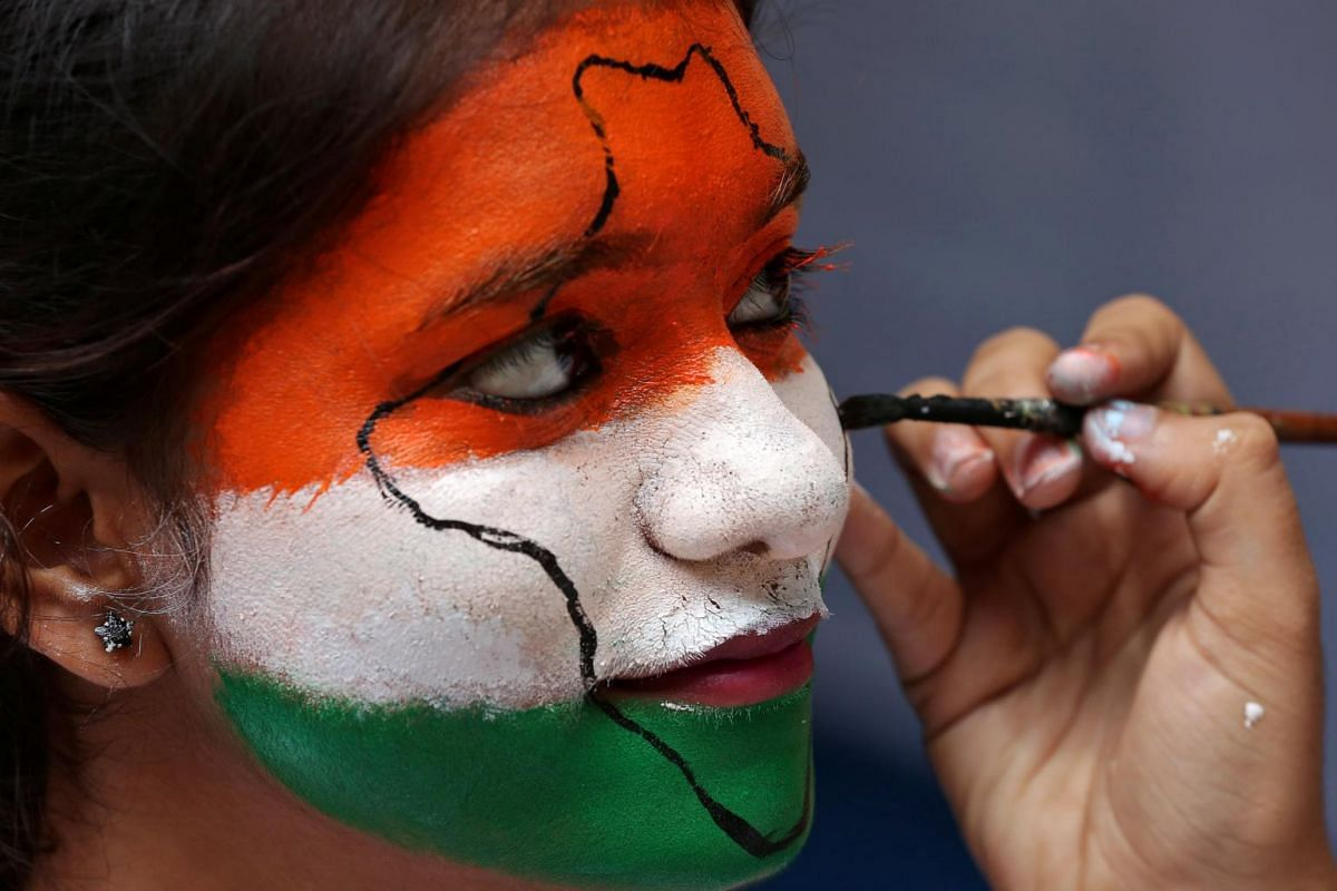 A girl gets her face painted in the colours of India's national flag, as she takes part in India's Independence Day celebrations inside a college in Chennai, India, on Aug 15, 2017.
