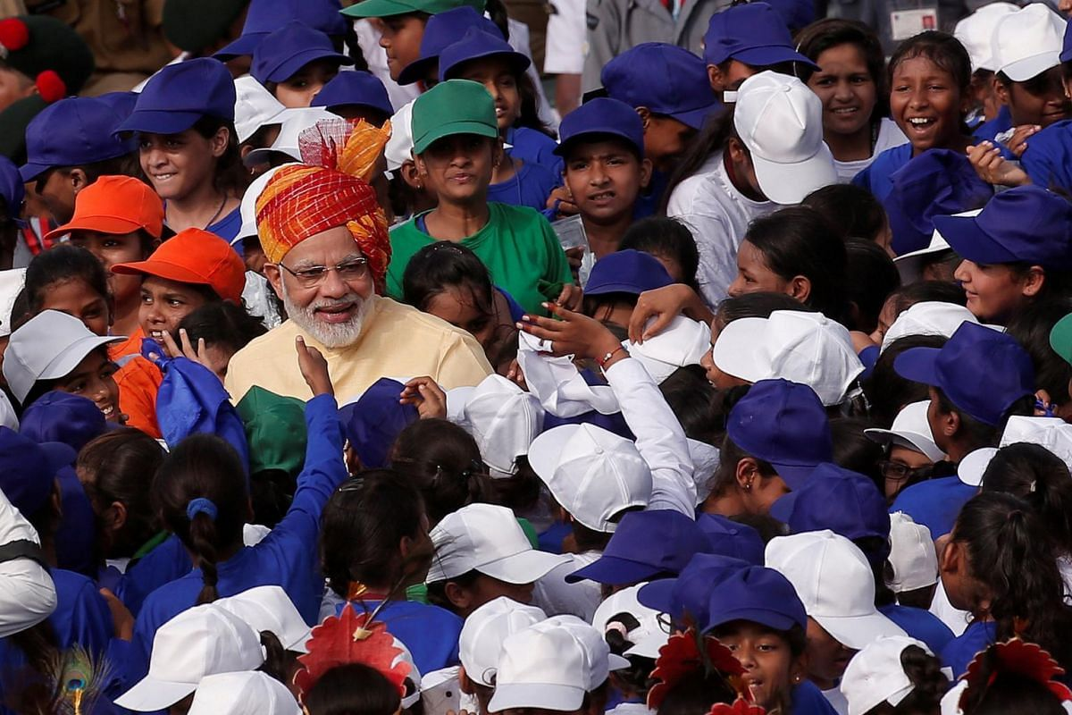 Indian Prime Minister Narendra Modi greets school children after addressing the nation from the historic Red Fort during Independence Day celebrations in Delhi, India, on Aug 15, 2017.