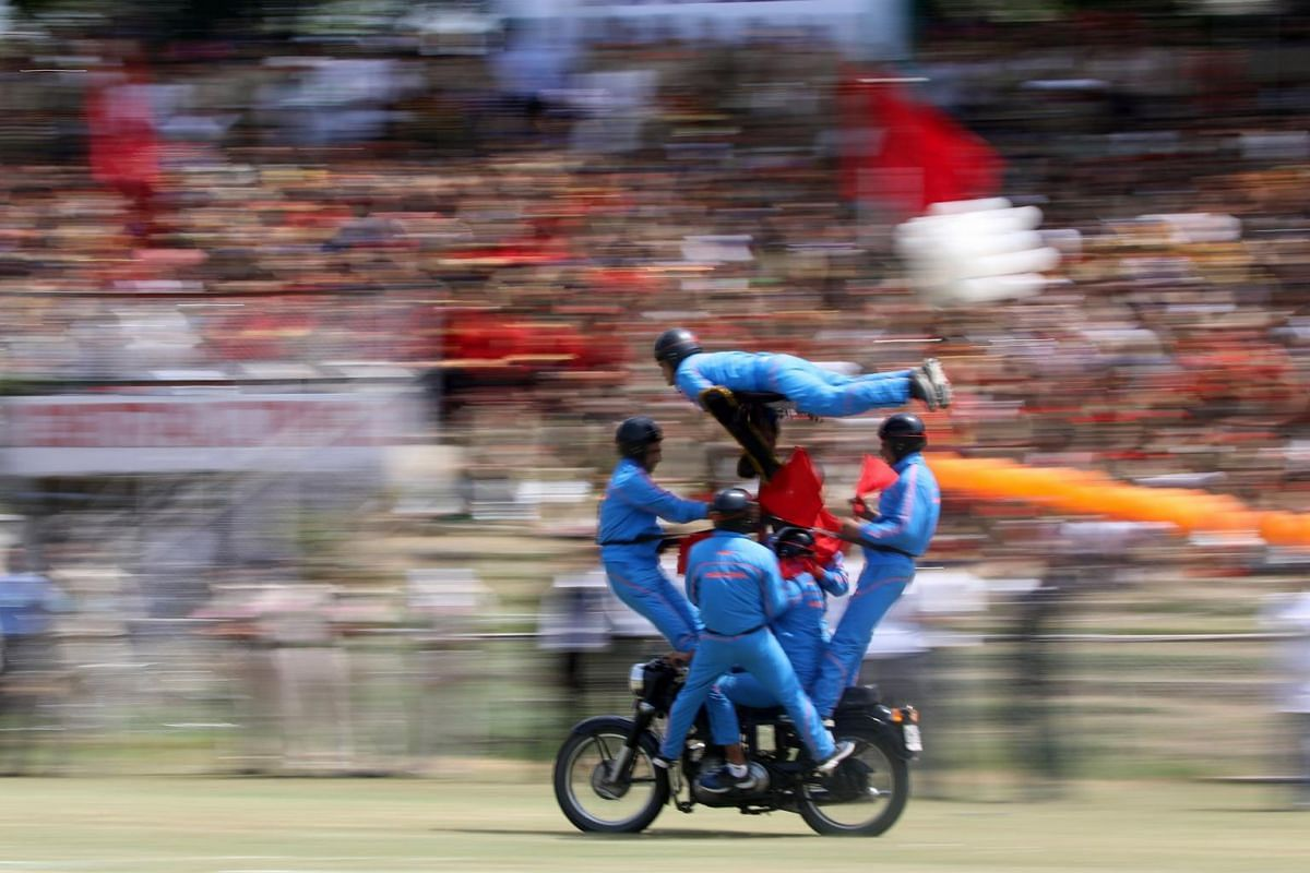 A daredevil team of Jammu and Kashmir Police perform acrobatics during India's Independence Day celebrations at Bakshi Stadium in Srinagar, the summer capital of Indian Kashmir, on Aug 15, 2017.