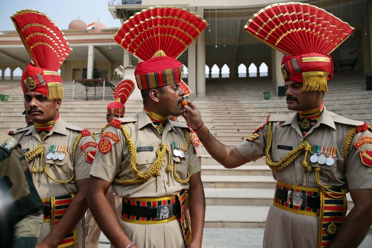 Indian Border Security Force (BSF), soldiers offer sweets to each other as they celebrate on the occasion of India's Independence Day at India-Pakistan Joint Check Post (JCP) Attari, some 30 km from Amritsar, India, on Aug 15, 2017.