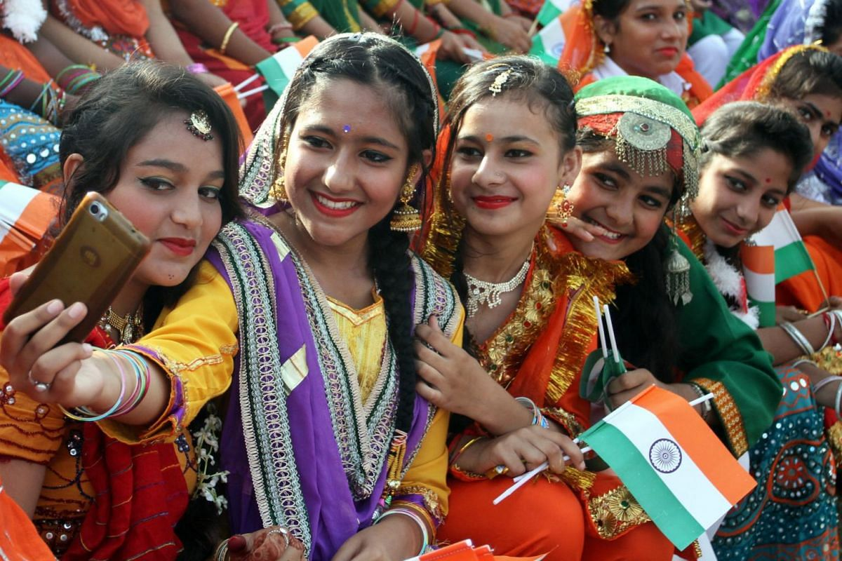 Indian school children take selfie picture as they perform cultural dance during the Independence Day celebrations in Jammu, the winter capital of Kashmir, India, on Aug 15, 2017.