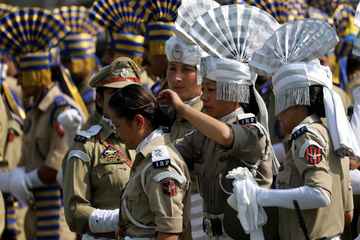 A female member of Jammu and Kashmir police adjusts the hair of her colleague as they take part during India's Independence Day celebrations at Bakshi Stadium in Srinagar, the summer capital of Indian Kashmir, on Aug 15, 2017.