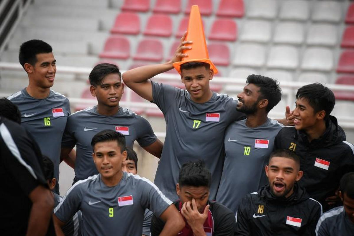 The Singapore Under-22 team in a relaxed mood as they put a traffic cone on birthday boy Irfan Fandi's head after a training session on Sunday (Aug 13), ahead of their SEA Games Group A match against Myanmar in Kuala Lumpur, Malaysia.