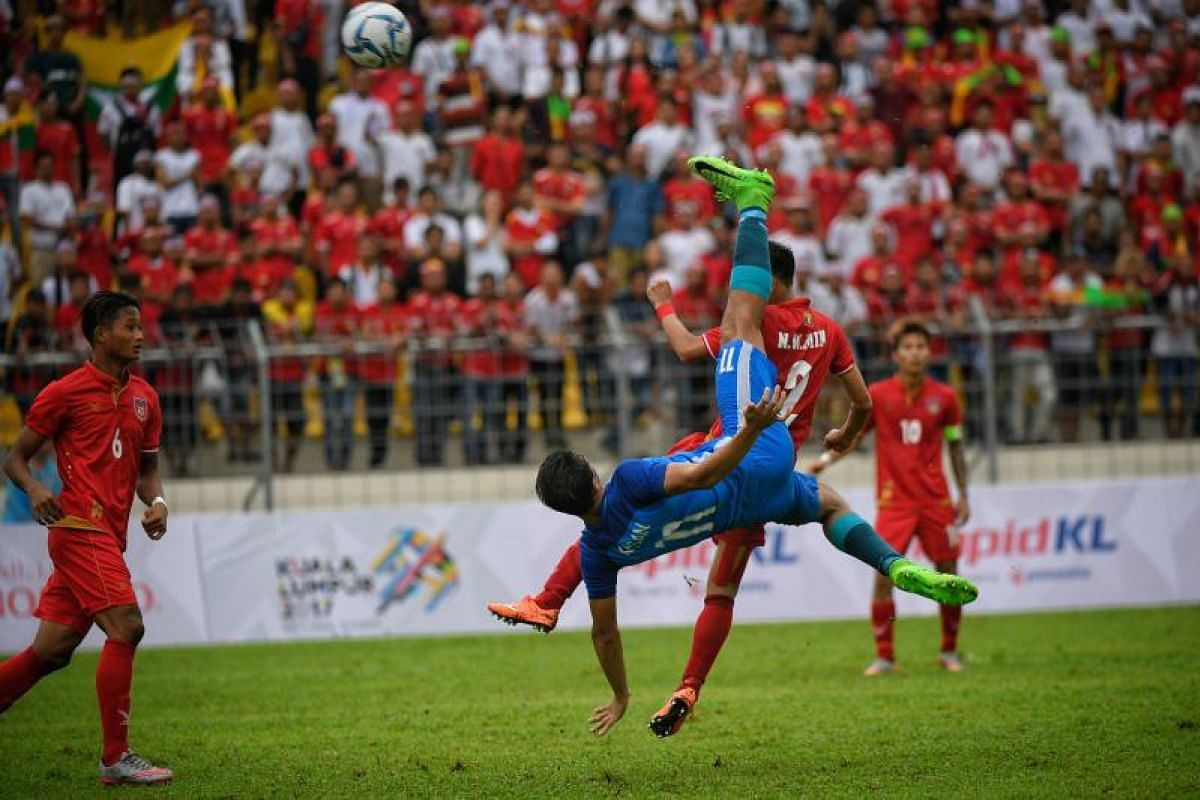 Ikhsan Fandi tries a bicycle kick during the SEA Games football match between Myanmar and Singapore at the Selayang Stadium in Kuala Lumpur on Monday (Aug 14).