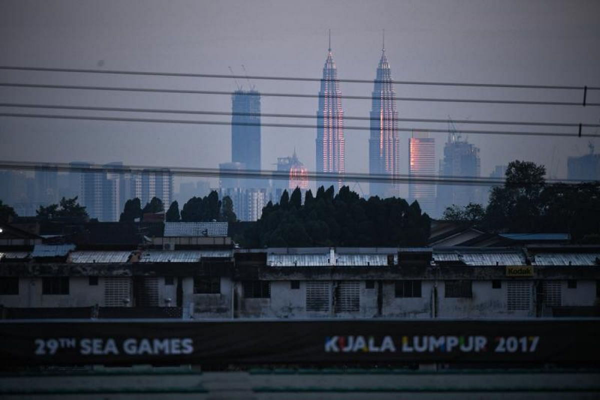 The KL Twin Towers are seen in the distance after the SEA Games football match between Myanmar and Singapore at the Selayang Stadium in Kuala Lumpur on Monday (Aug 14).