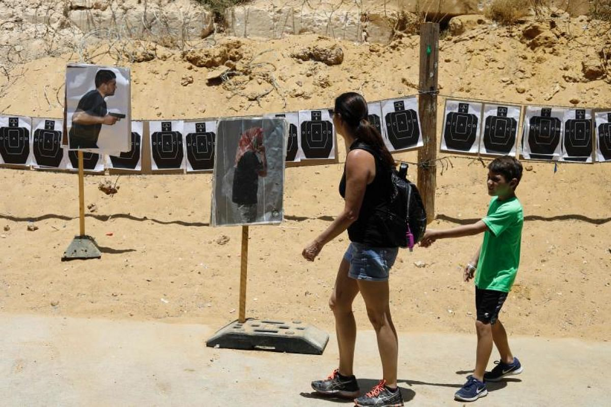 Foreign tourists viewing the shooting targets as they participate in a two-hour anti-terror course at the Caliber 3 shooting range, near the West Bank settlement of Efrat.