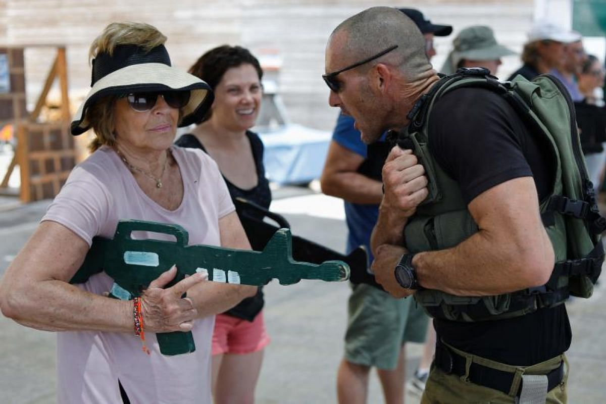 Foreign tourists training with a wooden gun as they participate in a two-hour anti-terror course at the Caliber 3 shooting range, near the West Bank settlement of Efrat.
